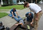 A 48hr Film Festival Crew works together to retrieve a custom prop from a storm drain..